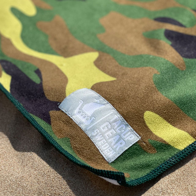 A closer look at a Towel Camouflage from TAC-UP GEAR laying in the sun on the beach
