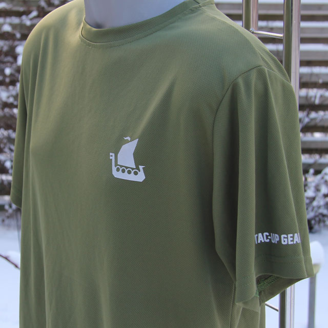 Breast logo showing on a Training T-Shirt Green in winter Swedish scenery background.