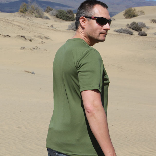 Right side view of a Training T-Shirt Green in sunny desert environment.