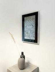 Kaaba dörr i silverfolie svart inramad