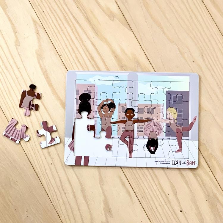 Pussel 24 bitar med ballerinamotiv, ett inkluderande pussel där bruna barn är representerade.