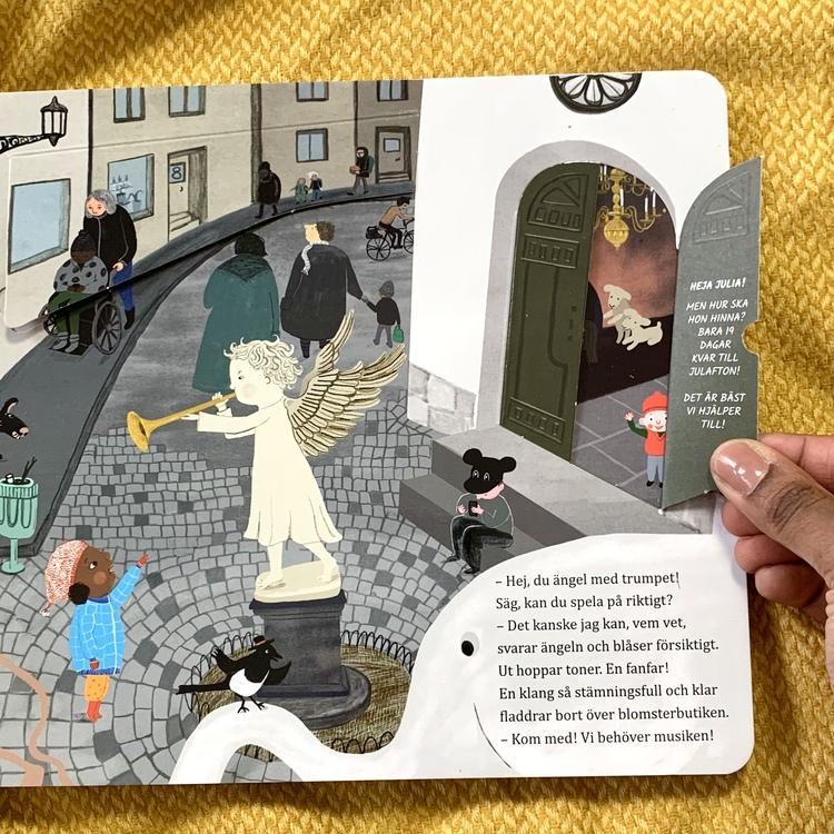Julkalendersaga med 24 luckor. Julias jul, bok från 3 år. Inkluderande barnbok.