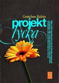 """Rubin, Gretchen """"Projekt lycka - eller varför jag lade ett år på att försöka sjunga på morgonen, röja i mina garderober, bråka rätt, läsa Aristoteles och på det stora hela ha mer kul"""" INBUNDEN"""
