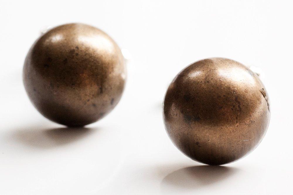 Bronsfärgade knappar, manschettknappar