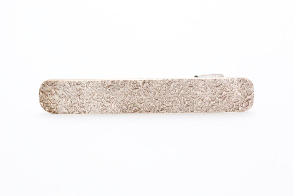 Mönstrad brons, slipsnål