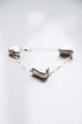 Silverhjärtan på armband