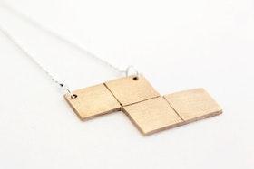 Tetris-hänge i brons på kedja