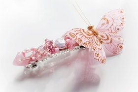 Hårspänne i rosa med fjäril