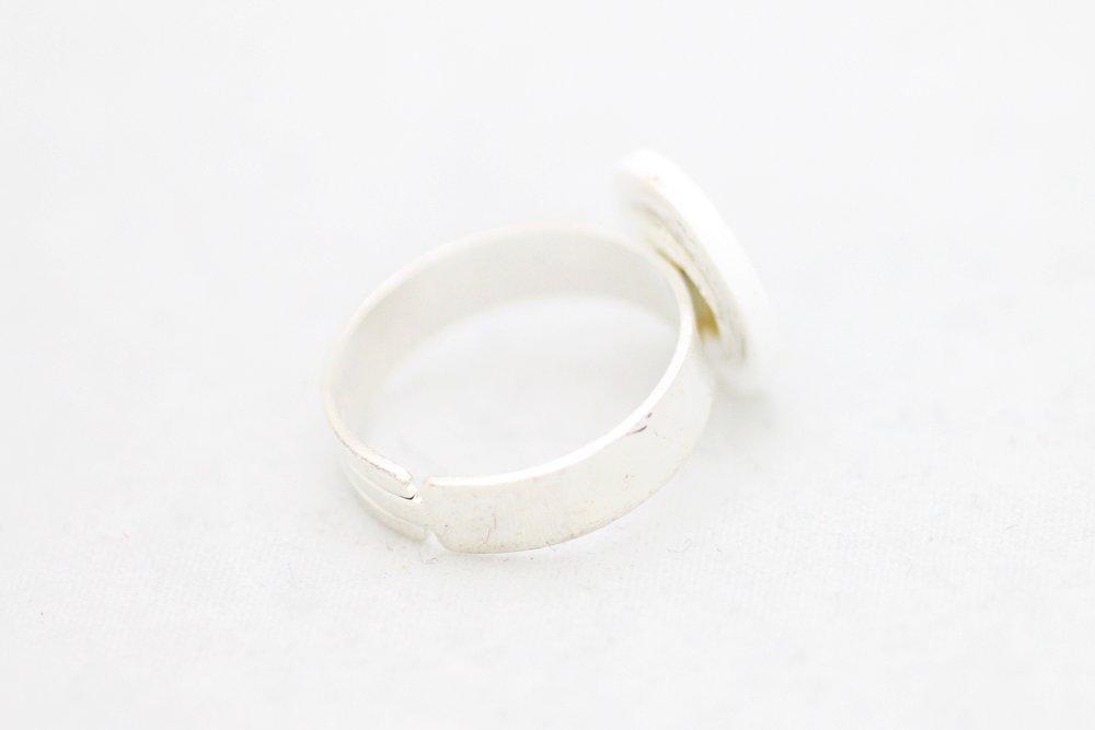 Grön och vit ring, feminist