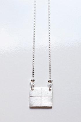 Tetris-hänge i silver på kedja