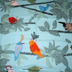 Tyg Blått med fåglar Bältesmuddar