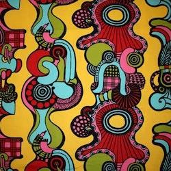 Tyg färgglatt gult Bältesmuddar