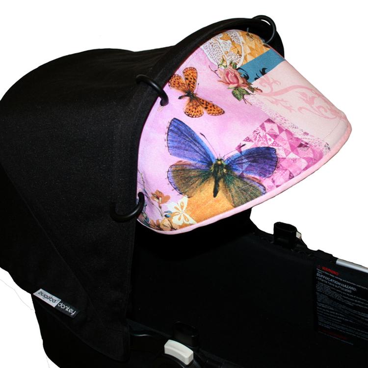 Solskydd till barnvagn. Rosa fjärilar