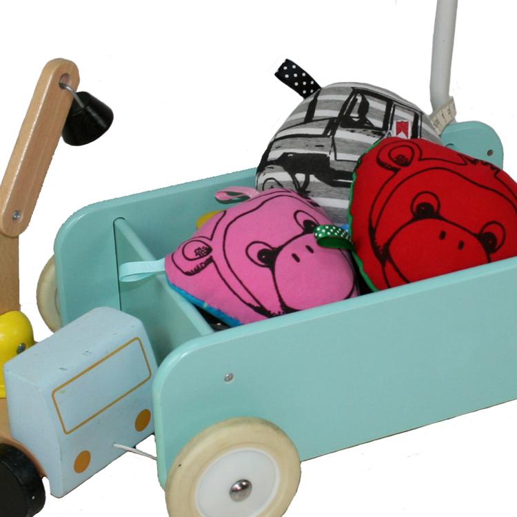 Lära gå vagn med babyleksaker i