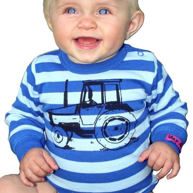 Bebisbody med traktortryck. Blå babybody med traktor valmet