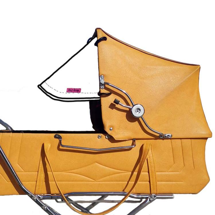 Sömnad av solskärm till retro barnvagn