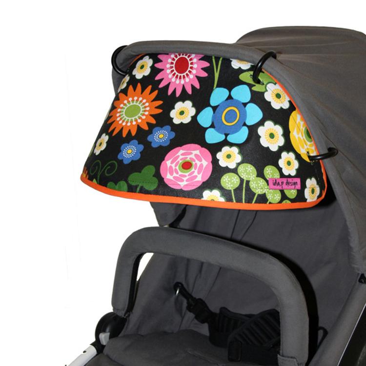 solskärm till barnvagn. Med svart och blommigt tyg från Åhlens