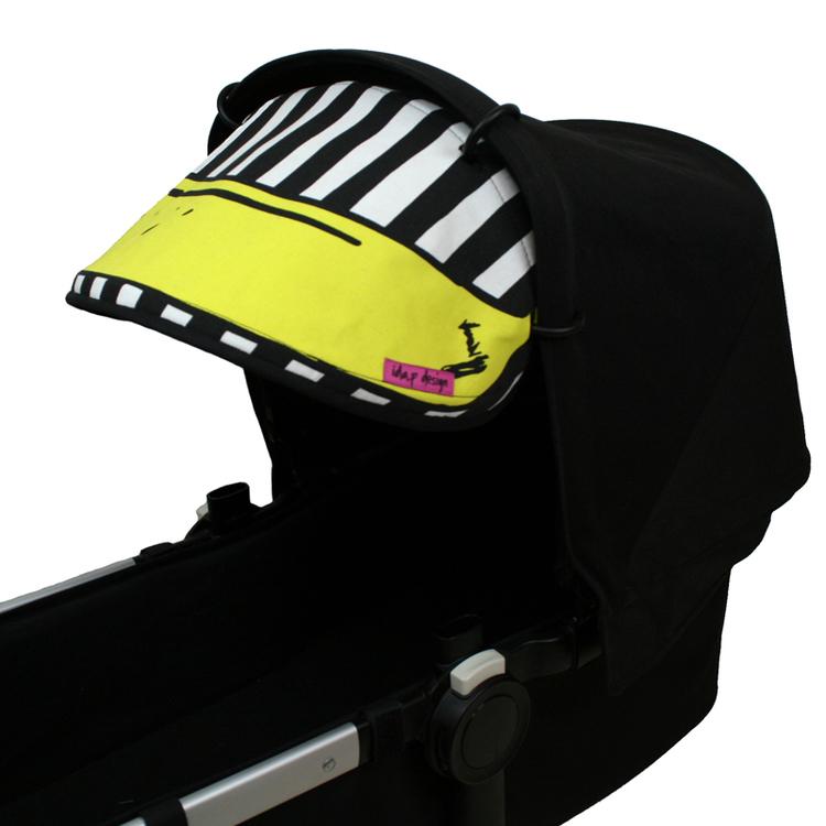 Solskydd till barnvagn. Sytt av IKEA´s banantyg