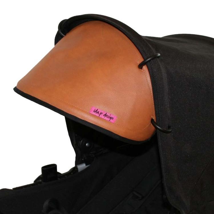 solskydd barnvagn i brun cognac konstskinn