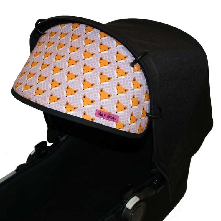 Solskydd barnvagn i rosa lila med rävar på