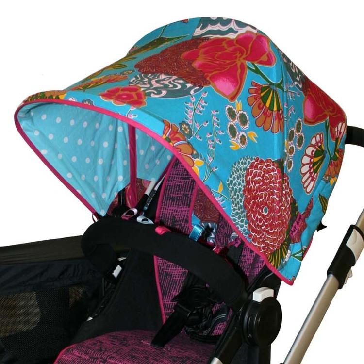 Tyg Blommigt turkos från Rice Solskydd barnvagn