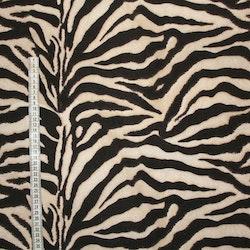 Zebramönstrat tyg beige/Brunsvart