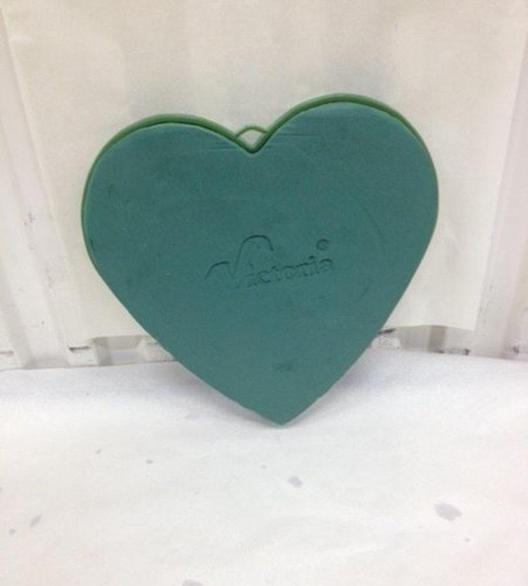 Grönt hjärta av stickmassa