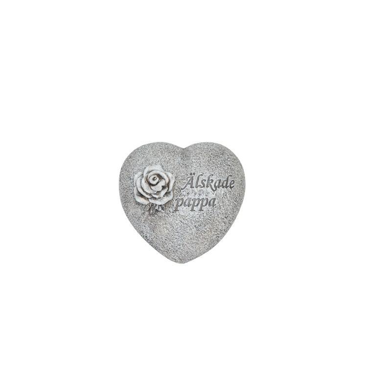 Ett hjärta i stenliknande material med texten älskade pappa