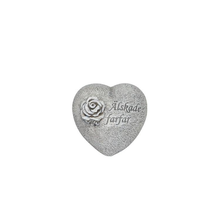 Ett hjärta i stenliknande material med texten älskade farfar