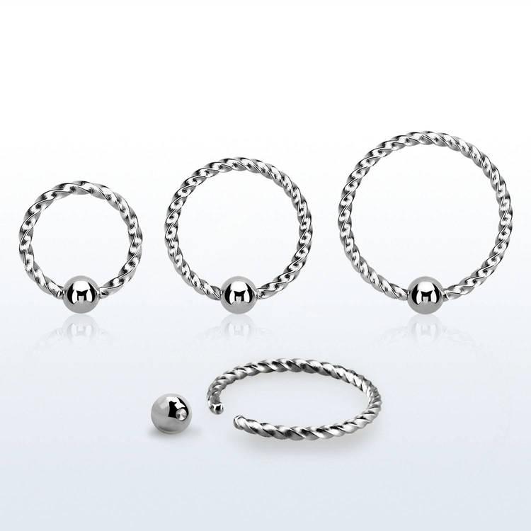 Sömlös ring twistad design 1mm med 2.5mm kula