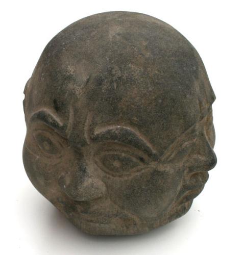 Buddhas fyra ansikten, Stenfigur