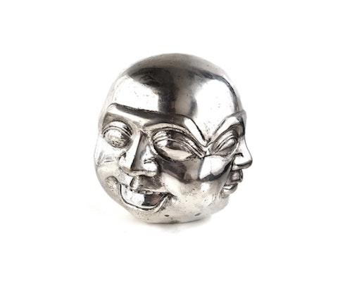 Buddhas fyra ansikten, Försilvrad brons