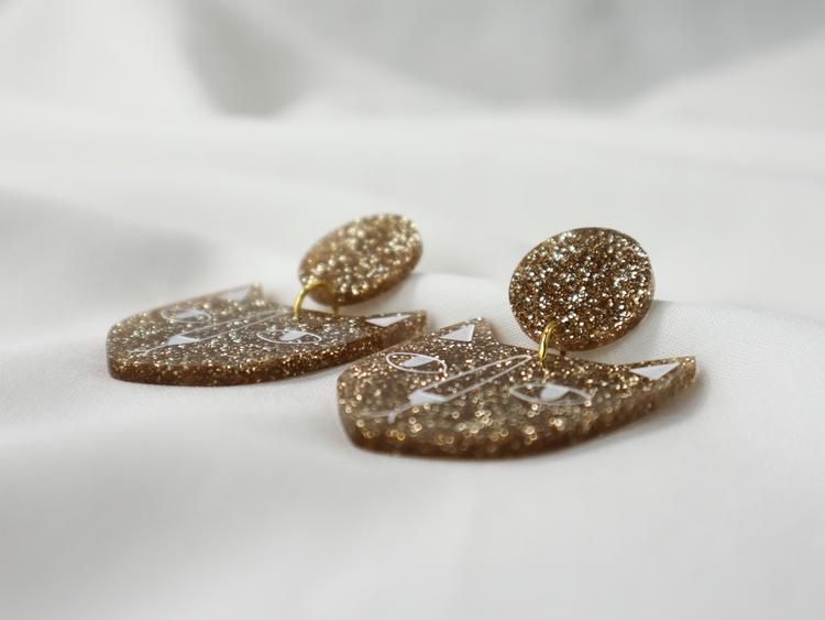 KATT (guldglitter)