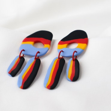 ÖGLAN (svart/röd/gul/blå)