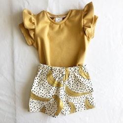 T shirt med volang gold ribb