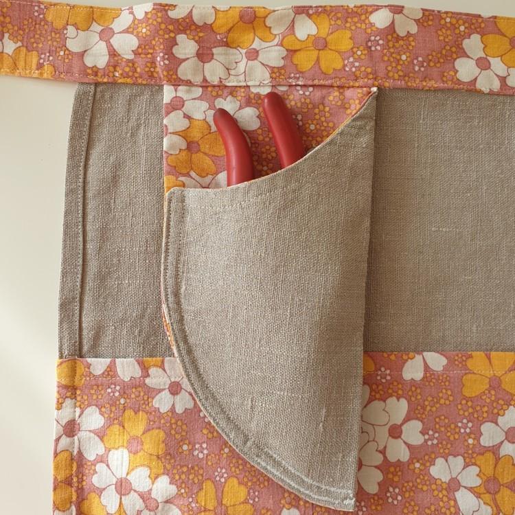 Trädgårdsförkläde med ficka för sekatör
