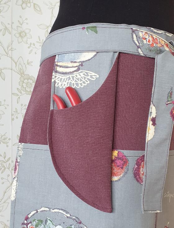 Trädgårdsförkläde med ficka för sekatören