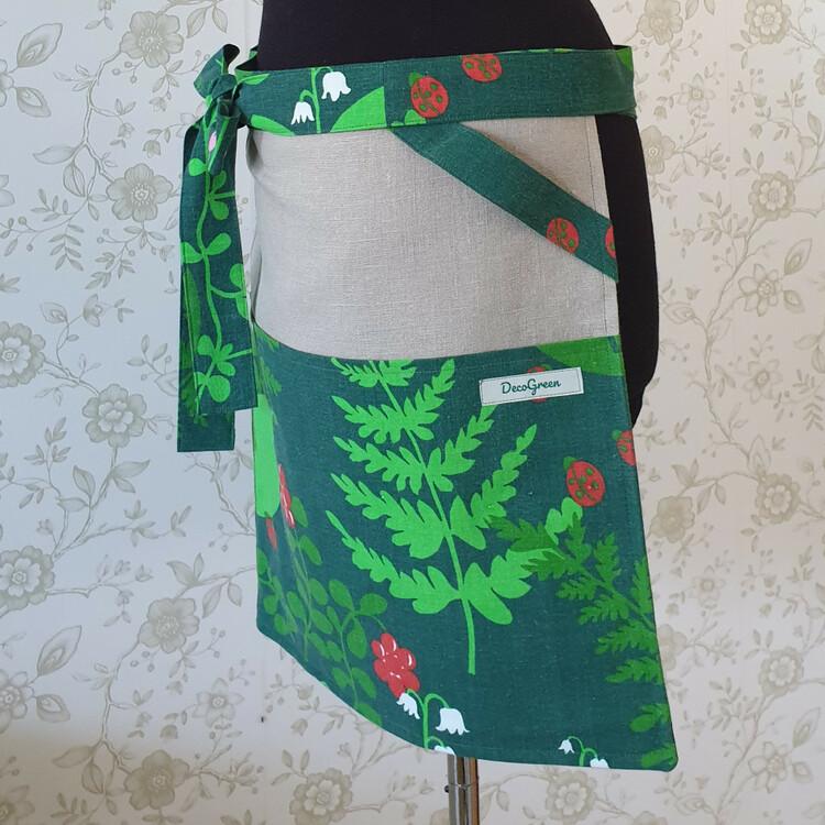 Trädgårdsförkläde med ögla för redskap