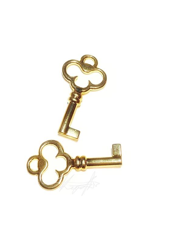 Berlock nyckel guld