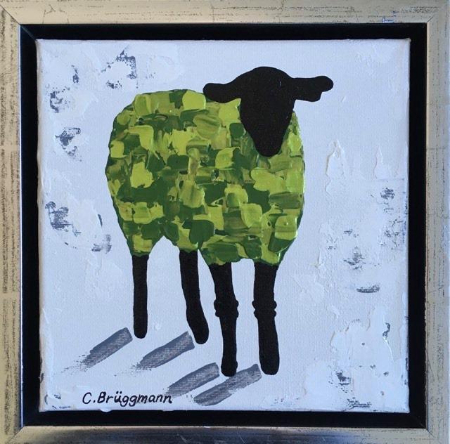 Fårtavlor är C.Brüggmanns kännetecken. Här en tavla med grönt får i skimrande metallicfärg.