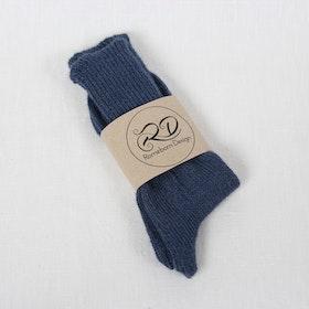 Blå sockar i Alpackagarn