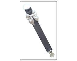 Mörkgrå napphållare med ljusgrå rosett - silver