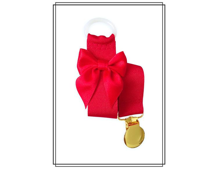 Röd napphållare med rosett - guld