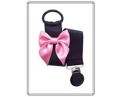 Svart napphållare med rosa rosett