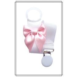 Vit napphållare med blekrosa rosett
