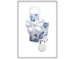 Napphållare blå blommor med vit rosett - vitt clip