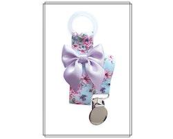 Napphållare med blommor och ljuslila rosett - silver
