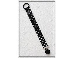 Napphållare svart med vita prickar - svart clip