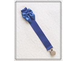 Blå napphållare med rosett - silver
