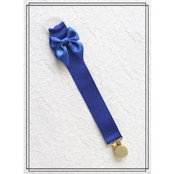 Blå napphållare med rosett - guld